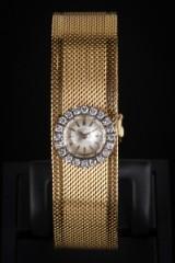 Universal Genève ladies' watch, 18 kt. gold