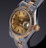 Rolex 'Datejust'. Ladies watch, 18 kt. gold and steel, with champagne-coloured dial, c. 1991