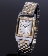Jaeger LeCoultre 'Reverso Lady'. Ladies watch, 18 kt. gold and steel with diamonds, c. 1995