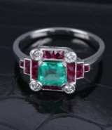 Vintage platinum ring with emerald, rubies and diamonds, mid-20th century