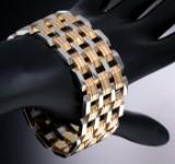 Bredt italiensk blokarmbånd af 18 kt. guld og hvidguld.