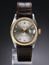 Rolex 'Datejust'. Herreur i 18 kt. guld og stål med brillantbesat sølvfarvet skive, ca. 1987