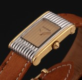 Boucheron 'Reflet'. Ladies watch, steel, partly gilt, with original strap and clasp