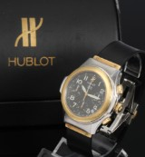 Hublot 'MDM Chronograph'. Men's watch, 18 kt. gold and steel with black dial