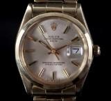 Rolex. Vintage herrearmbåndsur, model 'Oyster Perpetual Date' på original lænke, 14/18 kt guld