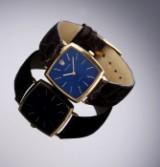 Rolex. Vintage herreur i 18 kt. guld med blå skive, ca. 1960-70'erne