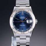 Rolex 'Datejust Turn-O-Graph'. Herreur i stål med blå skive - cert. 2003