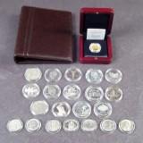 USA silverdollars og Malawi guldmønt