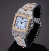 Cartier 'Santos Gelbee'. Ladies watch, 18 kt. gold and steel with white dia