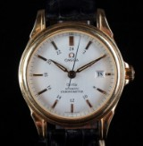 Omega. Herrearmbåndsur, model De'Ville Gmt Co-axial af massiv 18 kt guld