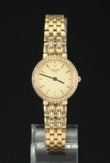 Certina. Damearmbåndsur af 18 kt. guld med brillanter