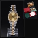 Rolex 'Datejust'. Dameur i 18 kt. guld og stål med champagnefarvet skive - boks + cert. 1989