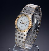 Omega 'Constellation Day-Date'. Men's watch of 18-carat gold and steel, around 1991