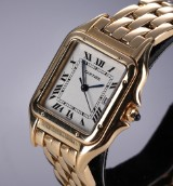 Cartier 'Panthere'. Mid-size ladies watch, 18 kt. gold with pale dial with date, 2000s